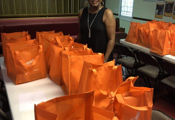 Orange bags containing school supplies